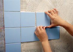 How to Use Adhesive and Grout for Wall Tiling